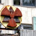 red and yellow radioactive signage at the building